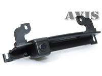Камера заднего вида Avis в ручку багажника для Nissan Tiida (хэтчбек)