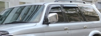 Дефлекторы окон (ветровики) для Mitsubishi Pajero Sport I (1998-2008 г.в.)